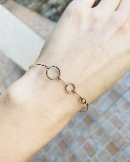 Bracelet avec des ronds bronze et or plaqué