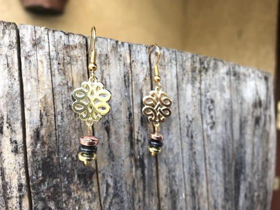 Boucles d'oreilles avec trois or différents