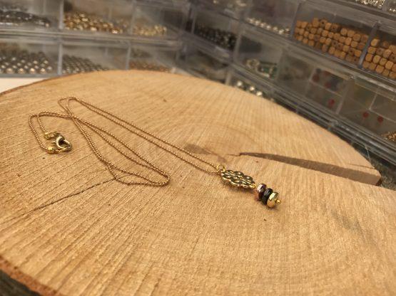 Sautoir avec trois differents or plaqués